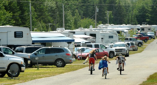 Children ride their bicycles at the Timberland Acres RV Park in Trenton on a warm summer's day.