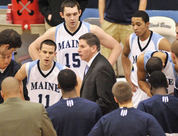Maine coach Ted Woodward (center) talks to his team during a timeout at a game in December in Orono. Maine's season ended with a 50-40 loss to Vermont in the America East tourney Saturday. It marked the seventh consecutive season the Bears have failed to win a postseason game under Woodward.