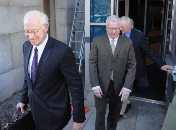Attorney Peter DeTroy leads his client, former Maine Turnpike Authority executive director Paul Violette, from the Cumberland County Courthouse Thursday afternoon, Feb. 9, 2012. Violette had just pleaded guilty to theft from his former employer.