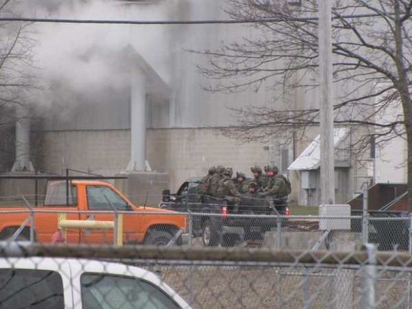 A team of State Police tactical officers were transported into the Verso Mill in Jay Wednesday by pickup truck. The officers are responding to standoff and hostage situation at the mill.