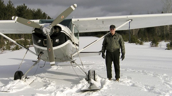 This January 2007 photo released by the Maine Department of Inland Fisheries and Wildlife shows Daryl Gordon standing next to a plane (not the plane in which he crashed) on a frozen lake.