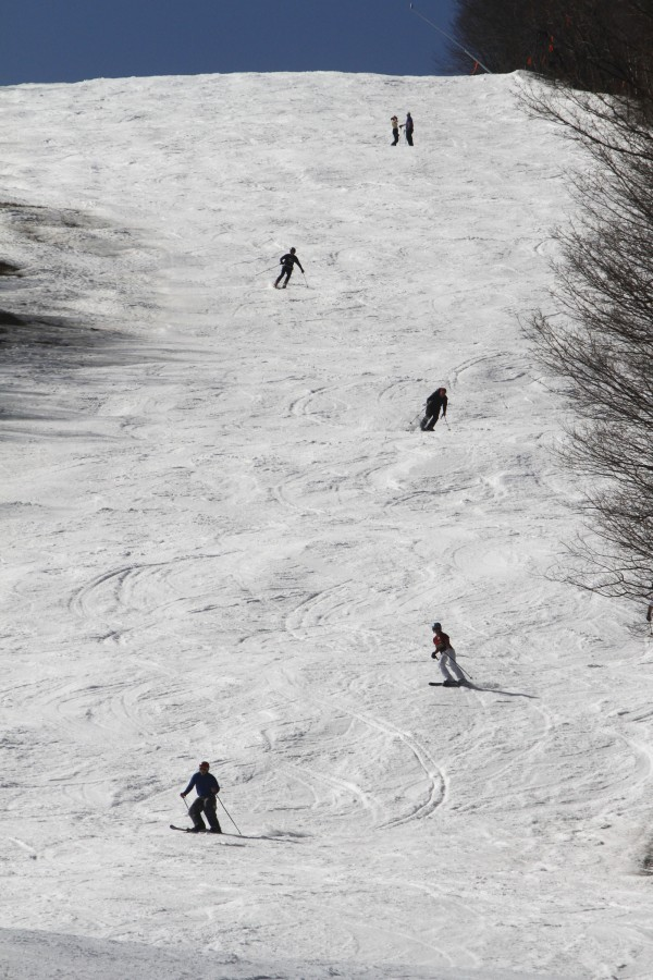 In this March 20, 2012 photo, skiers descend a trail at the Sugarbush Resort  in Fayston, Vt. Northern New England is experiencing some summerlike weather. Forecasters say the temperature should go past 70 degrees on Wednesday in Portland, Maine, smashing the old record by 10 degrees or more. And it'll be even warmer Thursday, moving toward the 80-degree mark.