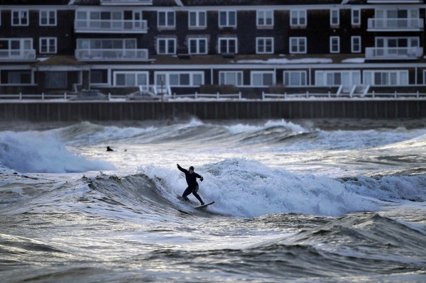 A surfer rides a wave at Gooch's Beach in Kennebunk on Saturday, March 3, 2012.