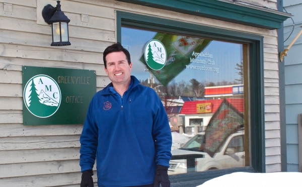 John D. Judge, the president of the Appalachian Mountain Club, stands outside AMC's Greenville office on March 5, 2012, after skiing for four days on AMC trails to visit their three Maine Wilderness Lodges. Judge officially became AMC's fourth president on Feb. 1, 2012.