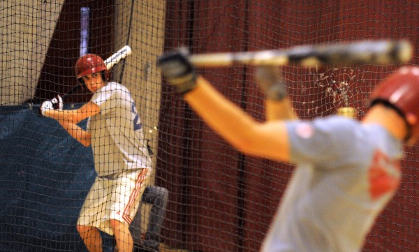 Bangor High School baseball team members Christian Corneil (left) and Cody Sevage swing their bats during practice at the school gym on Monday, March 26, 2012. The first practice rings in the season when the aluminum alloy bats will be replaced by composite and/or wooden bats based on the players' preference.