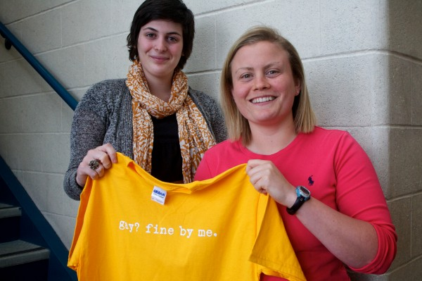 Brunswick High School math teacher and softball coach McKell Barnes (right) and senior and Gay-Straight Alliance president Julia Brown hold a T-shirt being sold as a fundraiser at the school.