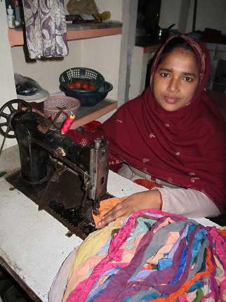 Bi Shahnaz Ara of Bhagalpur, India, makes silk ribbon yarn that will be imported by Nicole Snow of Sebec, owner of Darn Good Yarn, an Internet yarn shop. Ara is a widow with a small child to raise.