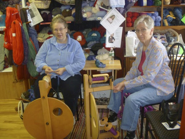 Friends Deb Colson (left) and Bev Richardson, both of Orrington, meet weekly to spin yarn at a shop in Brewer.