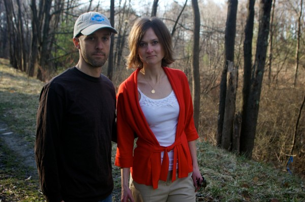 Todd Swinton, Erin Larson and their dog Emme stand on an undeveloped parcel of land known locally as Canco Woods in Portland on Thursday, March 22, 2012. The couple, and many of their neighbors would like to see the 12-acre lot preserved rather than developed.