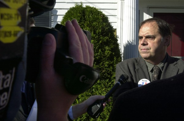 Paul Madore of the Maine Grassroots Coalition fields questions from reporters in front of the Christian Civic League office in Augusta in November 2005.