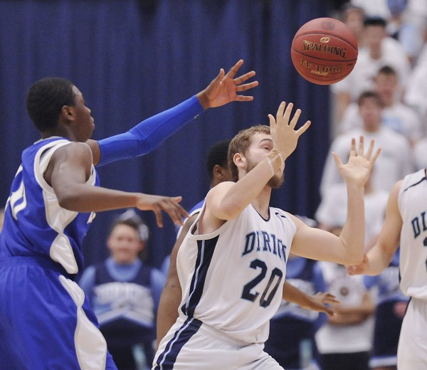 Lee Academy's  Boubacar Diallo, left, gets a hand on the ball handled by Josh Turbide (20) of Dirigo in the  first half of their  State Class  C championship game in Augusta, Maine Saturday, March 3, 2012.