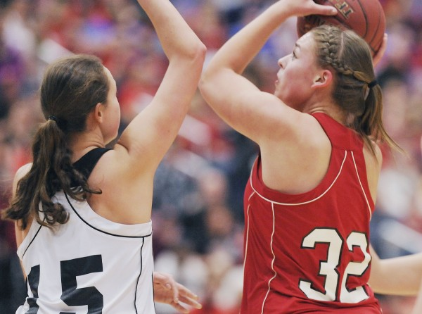 Central's Brianna Skolfield (32 ) pivots in the paint to put up a shot over Hall-Dale's Allison Crockett (15) in the first half of their  State Class  C championship game in Augusta, Maine Saturday, March 3, 2012.