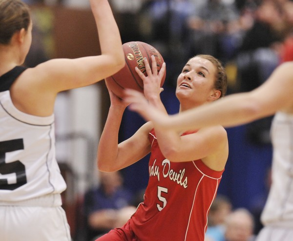 Central's Brianna Speed (5) drives for a shot over Hall-Dale's Allison Crockett (15) in the first half of their  State Class  C championship game in Augusta, Maine Saturday, March 3, 2012.