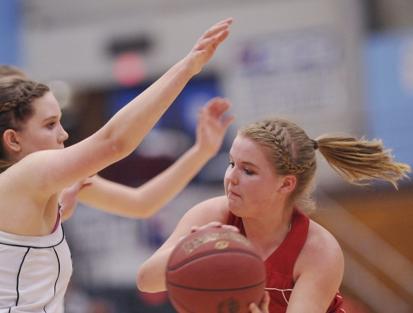 Central's Kaylee Harvey looks for a passing lane around Hall-Dale's Natasha Brown in the first half of their State Class  C championship game  in Augusta, Maine Saturday, March 3, 2012.