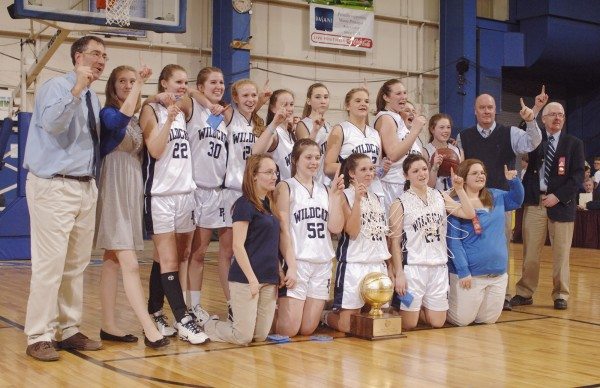 The Presque Isle girls basketball team poses for a photo as the state Class B basketball champions at the Bangor Auditorium Friday, March 2, 2012.