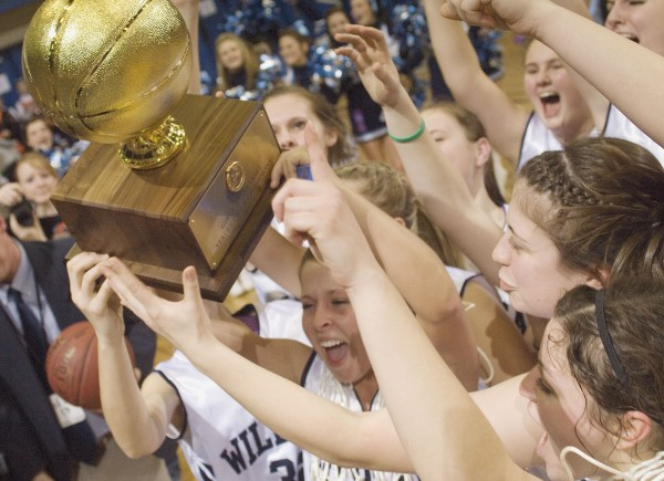 The Presque Isle girls basketball team celebrates with the gold ball trophy after winning the State Class B championship game at the Bangor Auditorium on Friday, March 2, 2012.