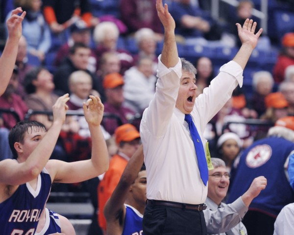 Jonesport-Beals boys basketball coach Gordan Faulkingham celebrates three more points in the final minutes of their Class D championship game against Forest Hills in Augusta Saturday, March 3, 2012.