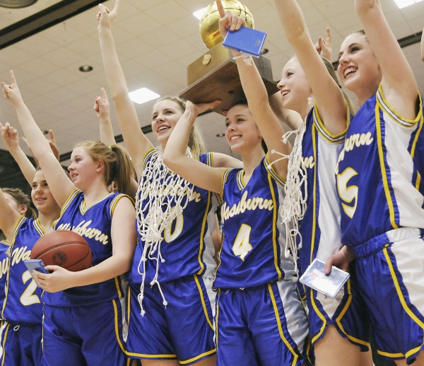 The Washburn High School girls basketball team celebates with the gold ball after winning the state Class D championship game in Augusta Saturday, March 3, 2012.