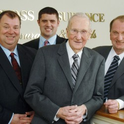 Woodrow Cross, 95 (front), poses with some of his family and co-workers: his son Brent (left) and son Royce (right). Behind them is Royce's son, Jonathan.