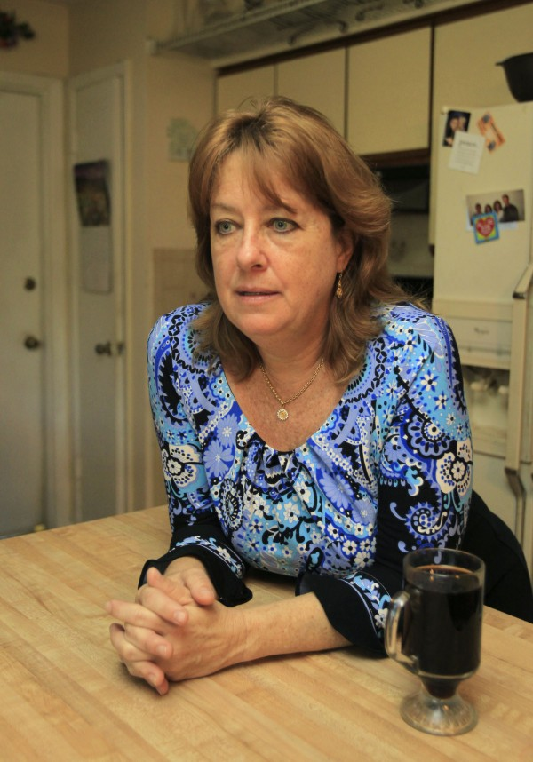 In this photo taken Thursday, March 15, 2012, Doreen Watson-Beard relaxes in her kitchen at her home in Leesburg, Fla. Watson-Beard, 49, is one of the millions of Americans living with Alzheimer's disease and other forms of dementia.