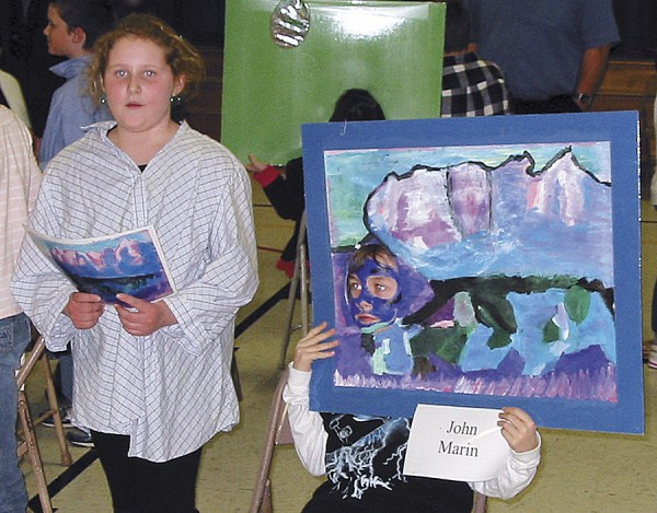 Emma Thayer (standing) and Zachary Hildebrandt (sitting) represent Maine artist John Marin in the Fruit Street School Living Art Gallery event.