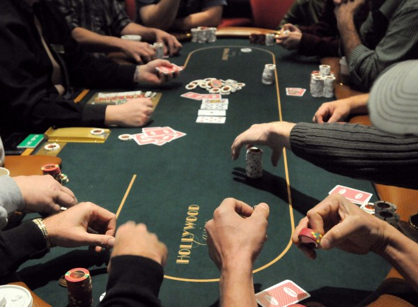 Patrons play poker at the Hollywood Casino in Bangor just after the the opening of table games at the casino Friday, March 16, 2012.