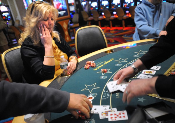 Donna Alexander of Alfred plays a blackjack game at the Hollywood Casino in Bangor Friday, March 16, 2012.