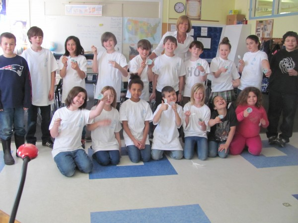 Tammy Baxter's fourth-grade class at Fisher Mitchell School in Bath poses for a photo Friday, March 30, 2012. The class has teamed up with Sanford-based ice cream maker Shain's of Maine in an effort to raise $5,000 to install a clean drinking water well in a third-world country.