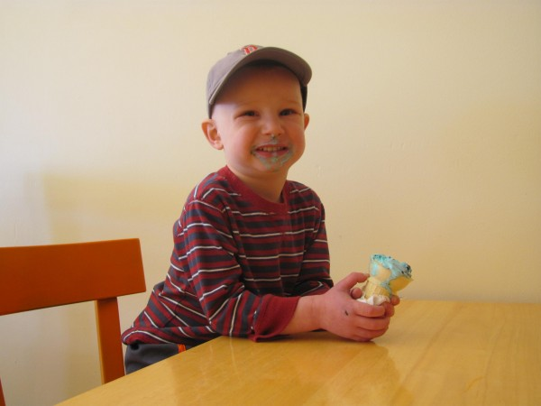 Three-year-old Elias Quinn Sommers of Bath enjoys a cone of H2O ice cream at Dot's Ice Cream Shop in Bath on Friday, March 30, 2012. The ice cream flavor was created as part of a project by local students to raise money for a clean drinking water project in the third world.