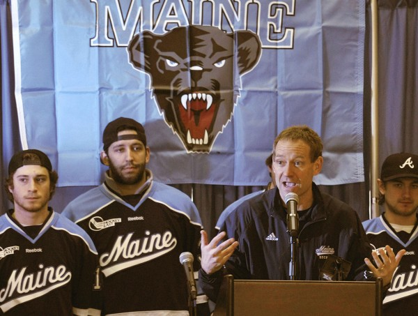 Maine hockey coach Tim Whitehead pumps up the crowd at a send-off rally for the men's hockey team at the Memorial Union at the University of Maine in Orono on Wednesday, March 14, 2012.