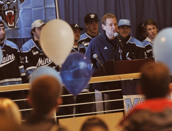 Maine hockey coach Tim Whitehead pumps the crowd up at a send-off rally for the men's hockey team at the Memorial Union at the University of Maine, Orono, Wednesday, March 14, 2012.