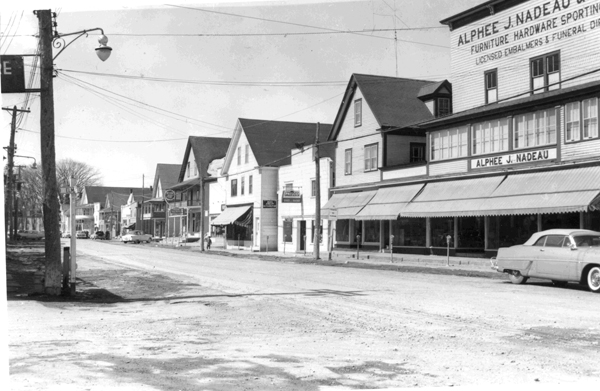 A view of Fort Kent's West Main Street in the 1950s shows the buildings of Alphee Nadeau (right) and two others destroyed in last weekend's fire.