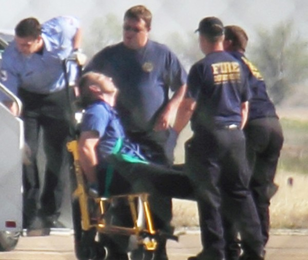 Emergency workers tend to a JetBlue captain that had a &quotmedical situation&quot during a Las Vegas-bound flight from JFK International airport, Tuesday, March 27, 2012, in Amarillo, Texas. Passengers said the pilot screamed that Iraq or Afghanistan had planted a bomb on the flight, was locked out of the cockpit, and then tackled and restrained by passengers. The pilot who subsequently took command of the aircraft elected to land in Amarillo at about 10 a.m., JetBlue Airways said in a statement.