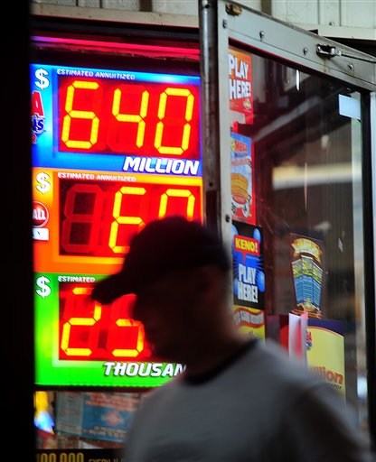 A customer walks out of the Riverside Travel Center in Hilton, Ga., late Friday night after purchasing a lottery ticket for the Mega Millions Lottery, which reached an estimated jackpot of $645 million for Friday night's drawing.