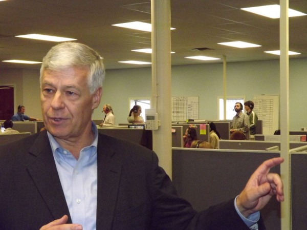 Rep. Mike Michaud talks with reporters during a visit to Argo Marketing Group's call center in Pittsfield on Friday, March 16, 2012.