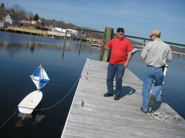 Dick Baldwin of Educational Passages tests one of his nonprofit group's miniboats to determine whether a recently installed portable receiver designed to pick up information from transmitters implanted in Atlantic salmon is working. Graham Goulette, a fisheries biologist at the NOAA field station in Orono, worked next to him Thursday, March 22, 2012.
