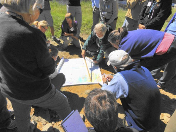 Students of the first ever Maine Master Naturalist Program course crowd around instructor and MMNP board member Fred Cichocki of Wiscasset while on a geology field trip in September 2011.