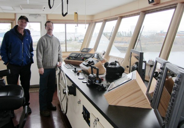 Maine State Ferry Service Manager James MacLeod (left) and Capt. Peter Drury stand in the pilot house aboard the E. Frank Thompson at the Rockland ferry terminal.