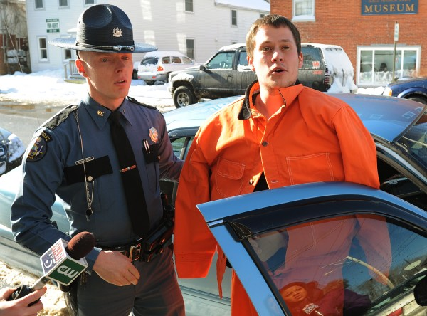Daniel Porter shouts out to supporters as he is escorted from a state police car by Trooper Jonathan Russell for his initial appearance at Belfast Superior Court in March 2012 in connection with the death of Florida firefighter Jerry Perdomo.