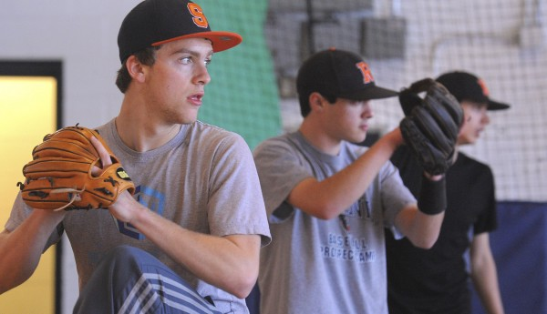 Dylan Maloney (left) one of the pitchers for the new Oceanside High School baseball team warms up during practice on Tuesday. Maloney joined the team after his former school, Georges Valley High School of Thomaston, merged with Rockland High School in the school consalidation process. Also pictured are pitchers Anthony Campagnoli (center) and Billy Joyce.