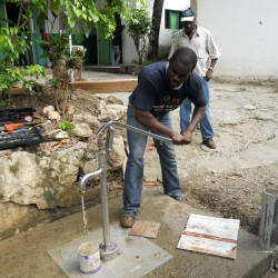 Josue Limprevil mans the newly installed Bison deep-well pump at the Justinian Hospital in Cap-Haitien, Haiti. The Bison pump was selected, purchased and installed by Konbit Sante, a public health based partnership based in Portland. Konbit Sante's volunteer engineers selected the Bison pump, which is manufactured in Houlton, because of its high quality design and ease of installation.