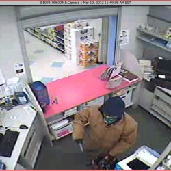 Guilford pharmacy robbery suspect still at large