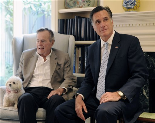 Republican presidential candidate Mitt Romney meets with former President George H.W. Bush in Houston last year.