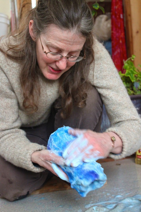 Rose Whitehead, 52, demonstrates wet felting on March 1, 2012, at her home studio in Waldo. She's making a blue and indigo felted hanging vase of dyed wool and an upcycled glass vase from the local transfer station.