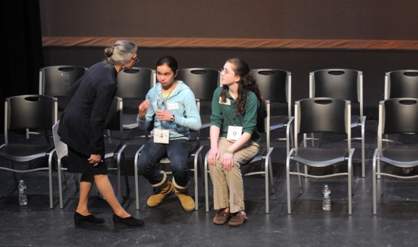 Sandip LeeAnne Wilson (left), the pronouncer of the 2012 Penobscot County Spelling Bee, speaks to Caitlin Hillery of the All Saints Catholic School (right) and Kaylyn Larkin of the Veazie Community School after the final round of the bee at Husson University in Bangor Saturday. Caitlin Hillery won the bee and she will represent Penobscot County in the Scripps National Spelling Bee in Washington, D.C.