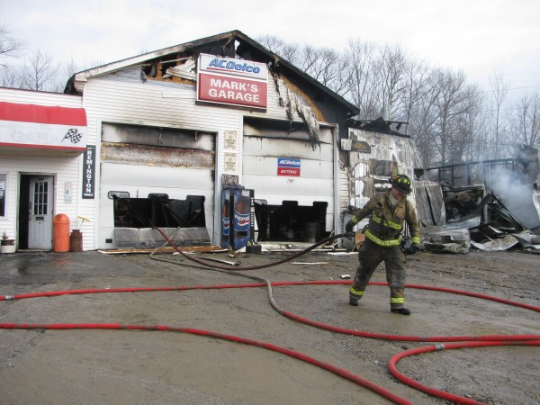 A firefighter works at the scene of a fire at Mark's Garage on Route 1 in Stockton Springs. A fire that broke out Tuesday, March 13, 2012 destroyed the building, which was insured, according to officials.