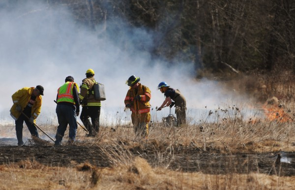 Firefighters from several different area departments, including Levant and Stetson,  put out a grass fire in a field belonging to James Pimental on the Wolfsboro Road in Stetson on Thursday, March 22, 2012.