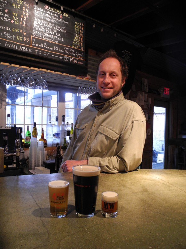 David Carlson, the owner of Three Tides in Belfast poured (from left) Illegal Ale-Ien, a Sea Level Stout and a glass of T2-R9 Barleywine before the bar's opening party on St. Patrick's Day.