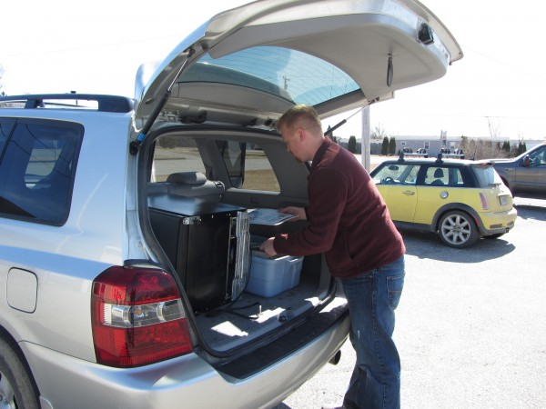 Mark Haskell of Thomaston, a former sports reporter for Village NetMedia, fills his vehicle with belongings Monday, March 12, 2012. Village NetMedia closed its doors at the end of the day Friday, March 9, 2012.
