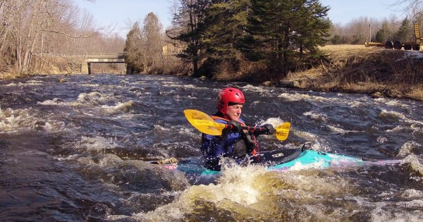 Skip Pendleton, 78, of Belfast negotiates the rapids on the St. George River in Monroe on Sunday, March 18, 2012.  Pendleton and members of the Penobscot Paddle and Chowder Society started their season Saturday and will take part in a large number of whitewater trips throughout the year. The unseasonably warm weather will continue this week.
